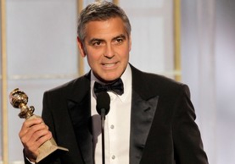Actor George Clooney displays his Golden Globe
