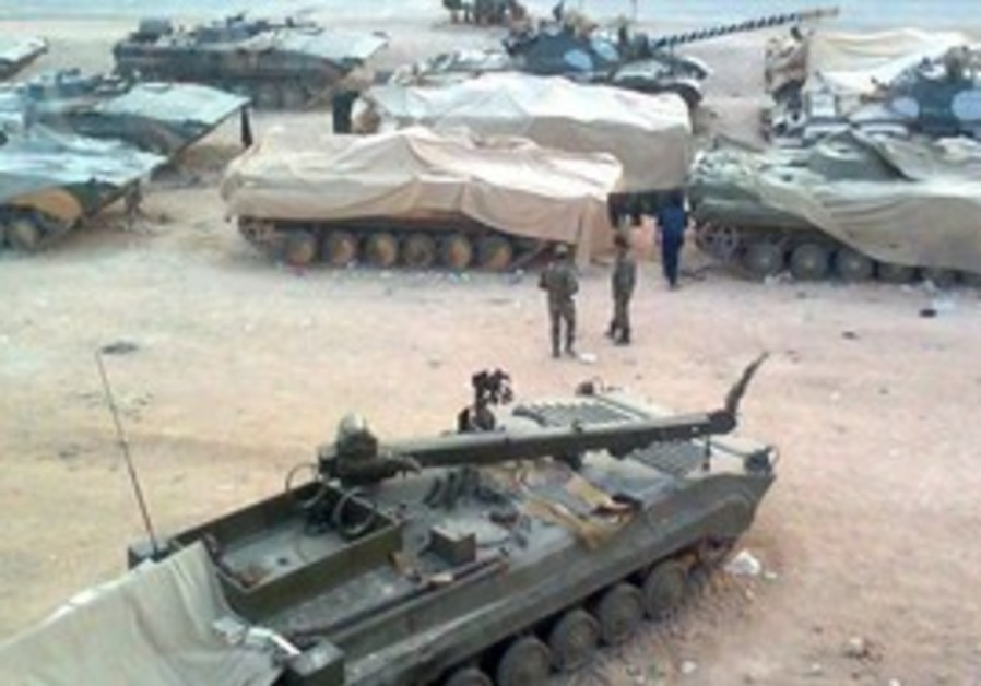 A Syrian tank outside Homs.