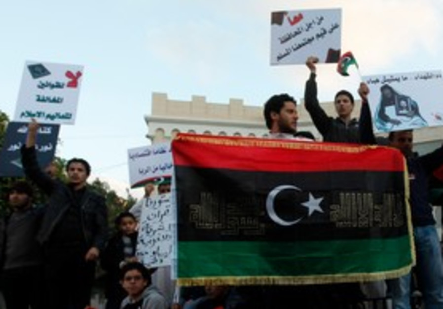 Libyan Muslims rally in support of sharia law