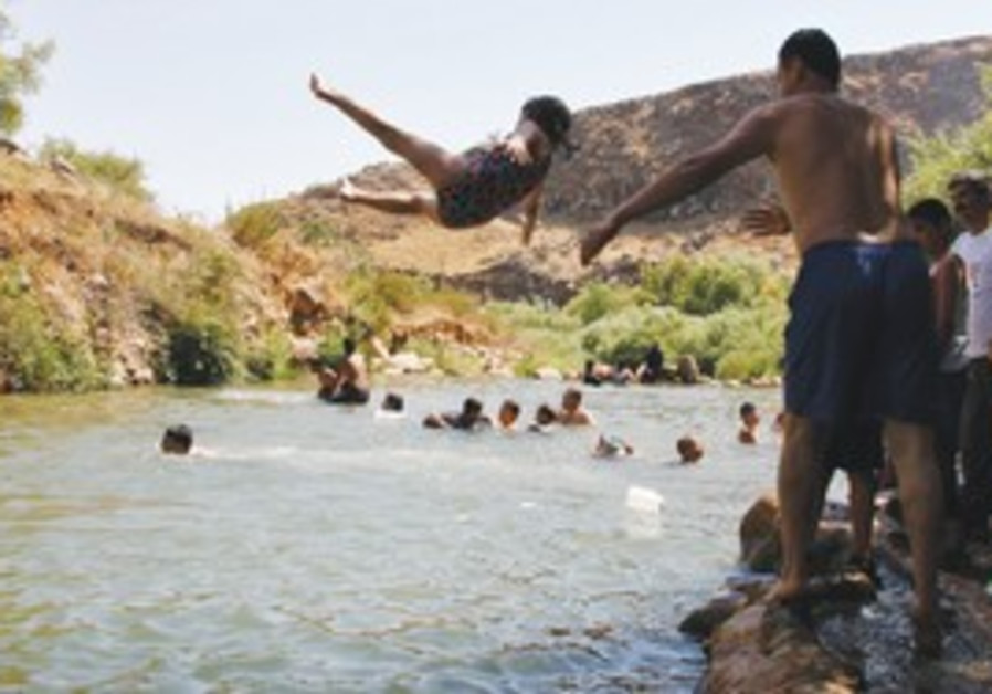 Lebanese villagers play in water