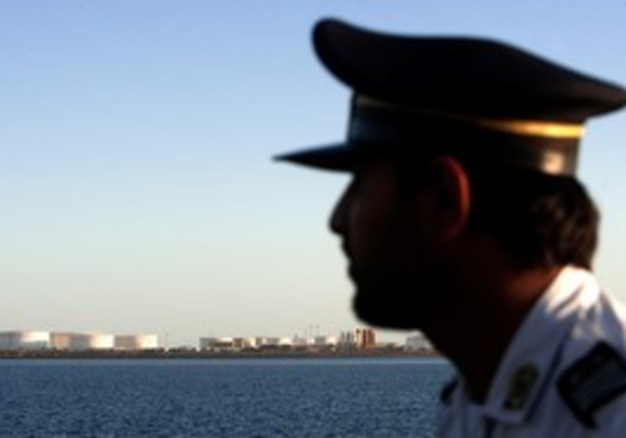 Iranian officer looks at Strait of Hormuz