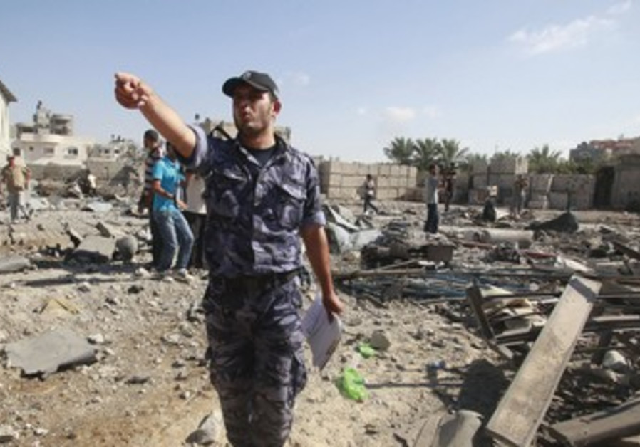 Member of Hamas security forces at site of strike