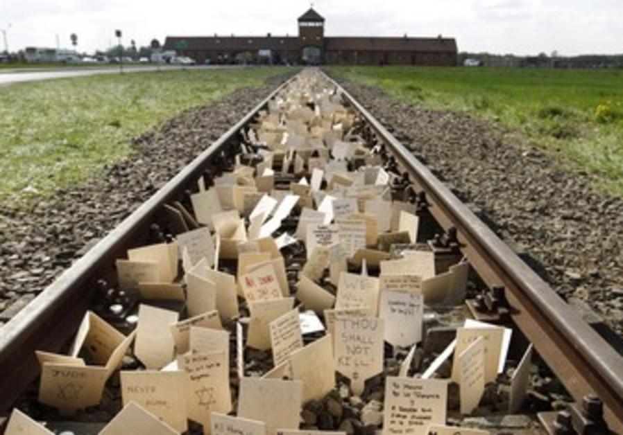 Placards placed on railway to Birkenau