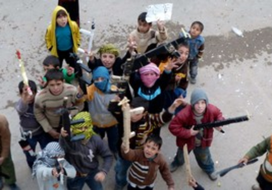 Children hold toy  weapons in anti Assad protest