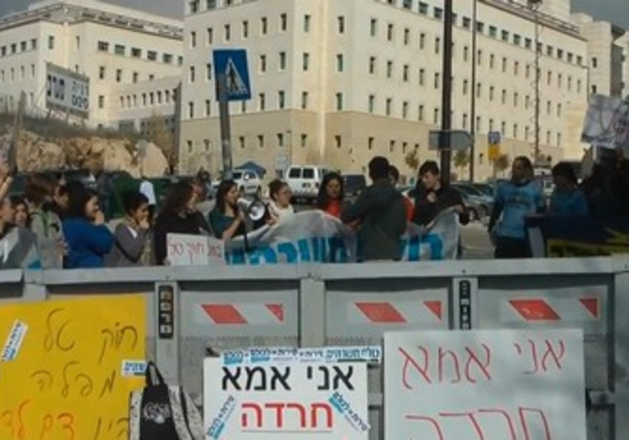 Activists protest Tal Law at PMO in J'lem