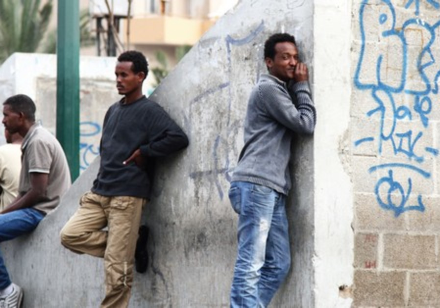 Sudanese and Eritrean refugees gather in Levinsky