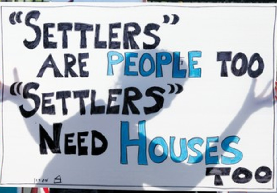 Settlers protest sign