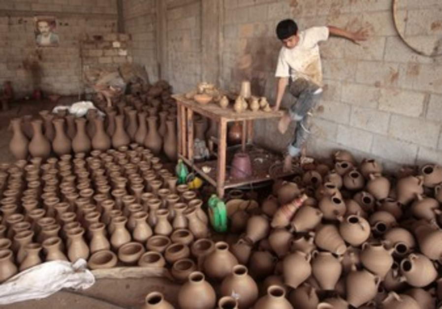 Palestinian at pot factory in Gaza Strip