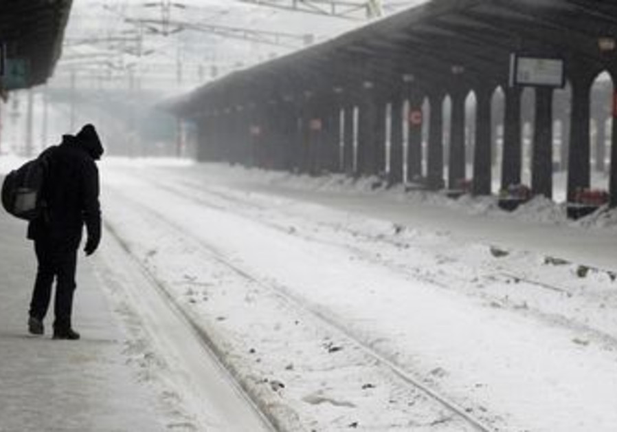 Man walks through empty rail station in Bucharest