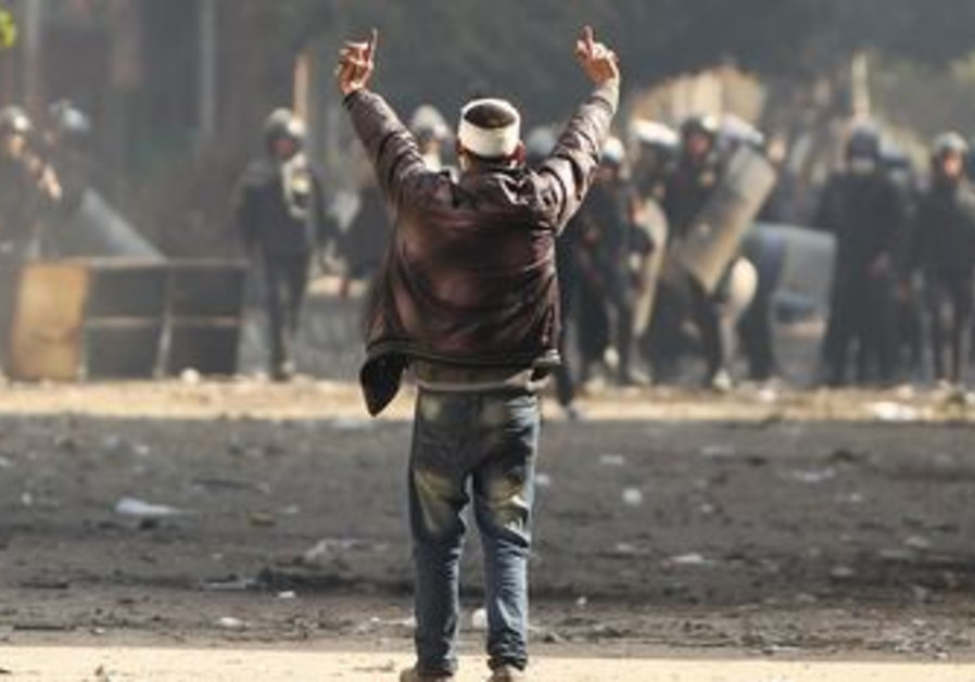 Protester gestures at police during Cairo clashes