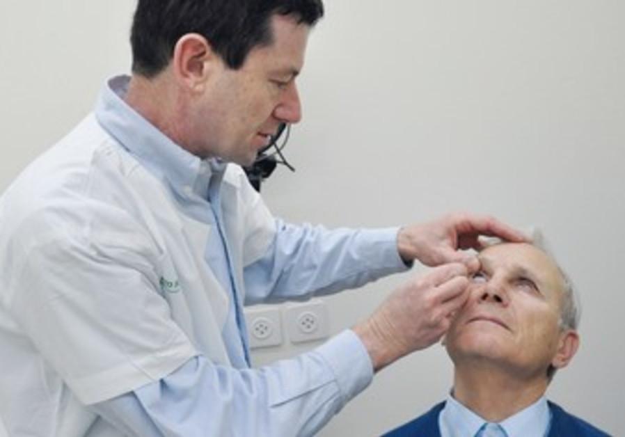 Dr. Markovich examines Dr. Vladimir Promovich