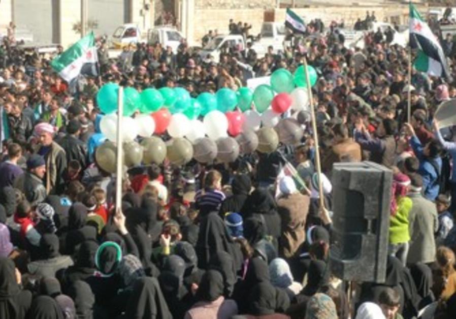 Syrian demonstrate against Assad