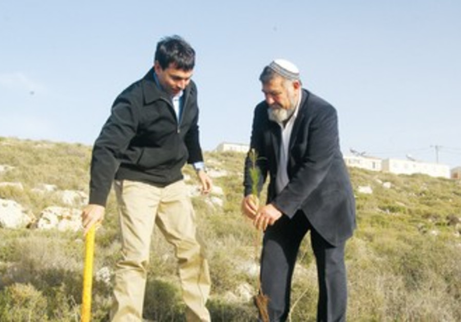 Danny Danon and Gershon Mesika plant a tree