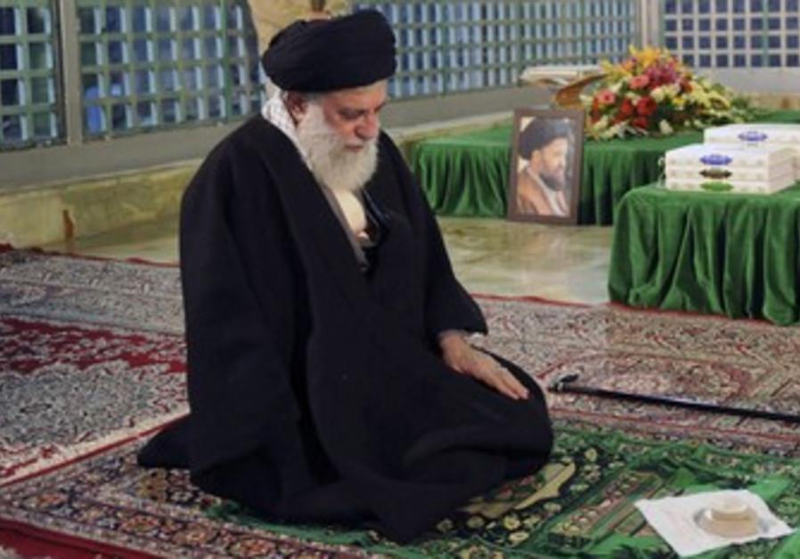 Ayatollah Ali Khamenei prays