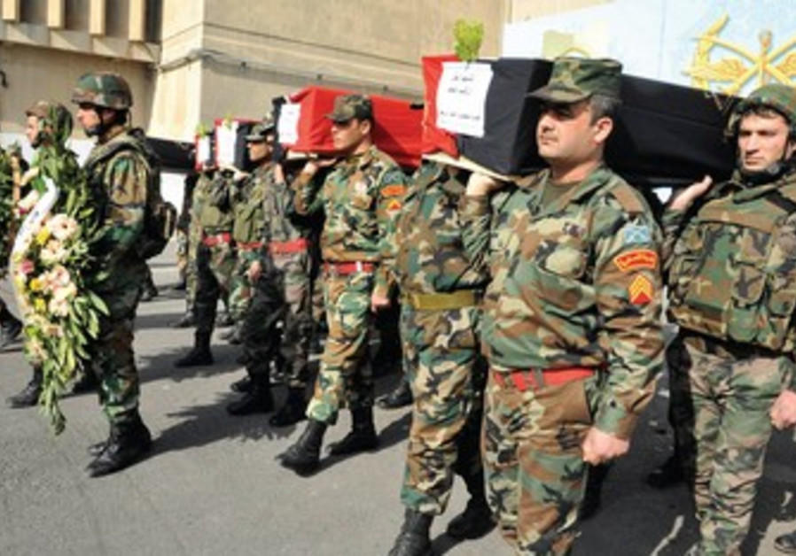 Syrian soldiers bury their comrades in Damascus