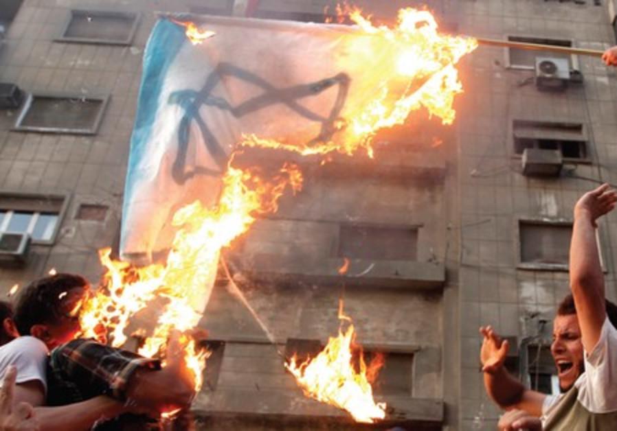 Protesters burn Israel flag at embassy, Cairo