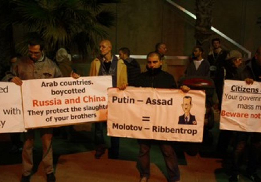 Activists hold candlelight vigil for Syria in TA