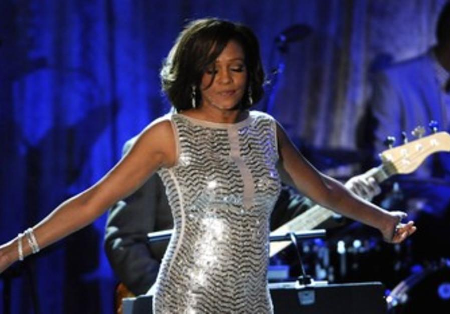 Whitney Houston performs at the Pre-Grammy Gala