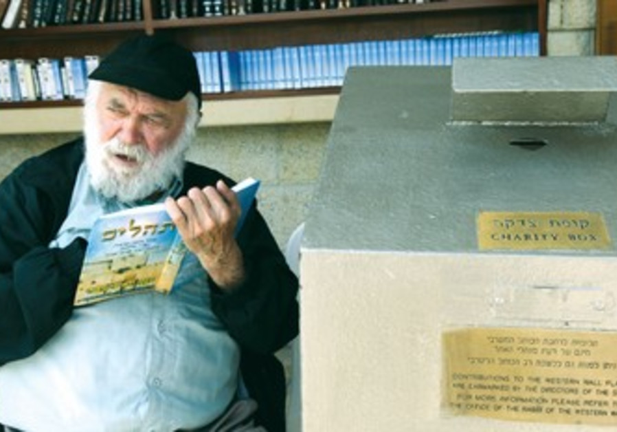Elderly Israeli man reads psalms