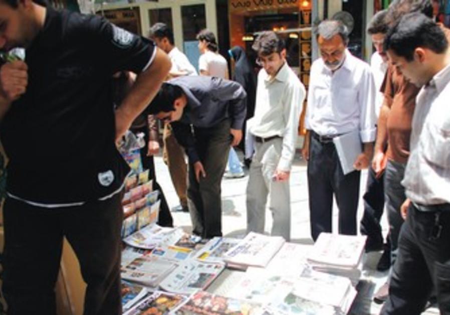 Iranians read newspapers in Tehran