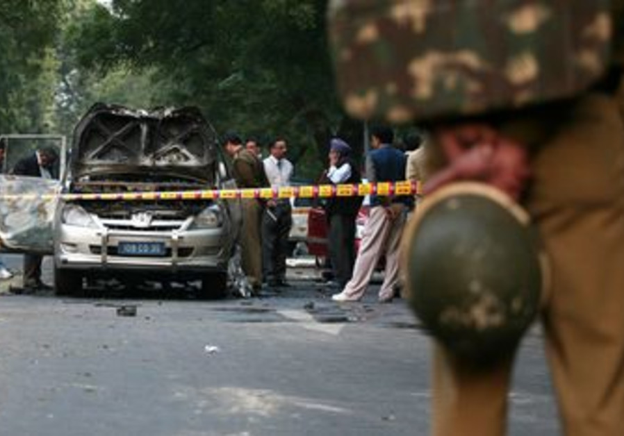 Indian police inspect bombed car in New Delhi