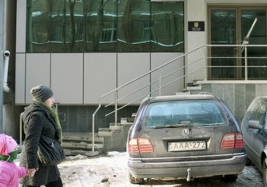 People walk by Israel embassy in Tbilisi, Georgia