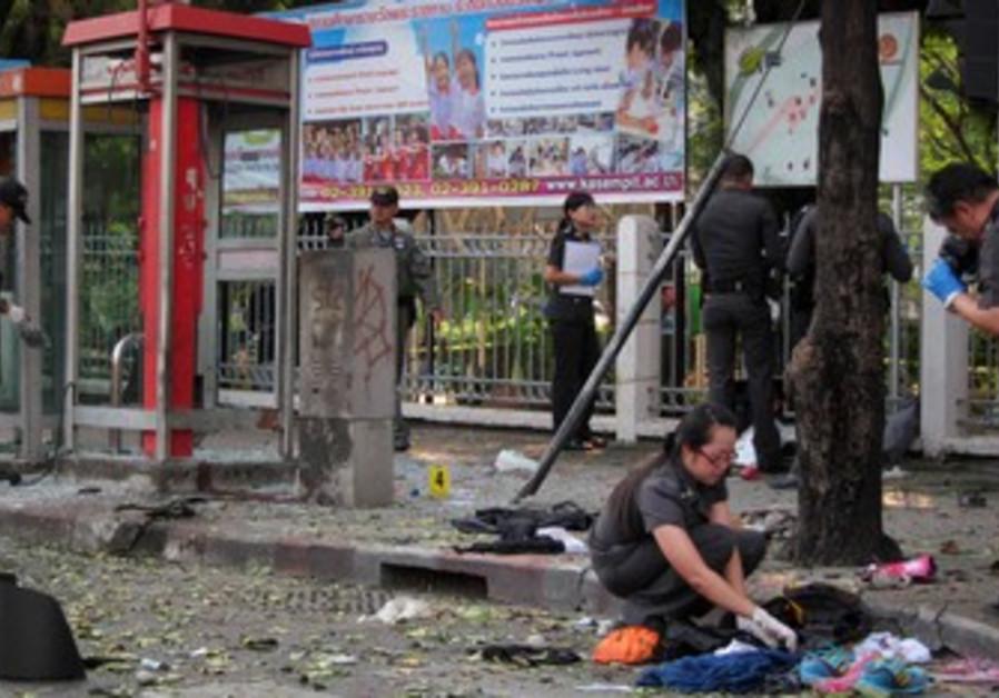 Police investigate site of blast in Bangkok