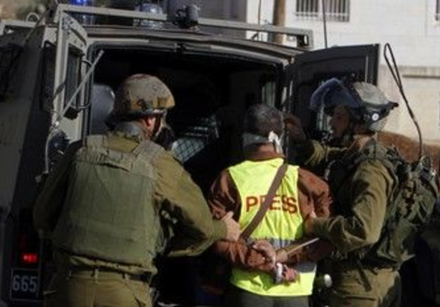 IDF soldiers detain a journalist in Nabi Saleh