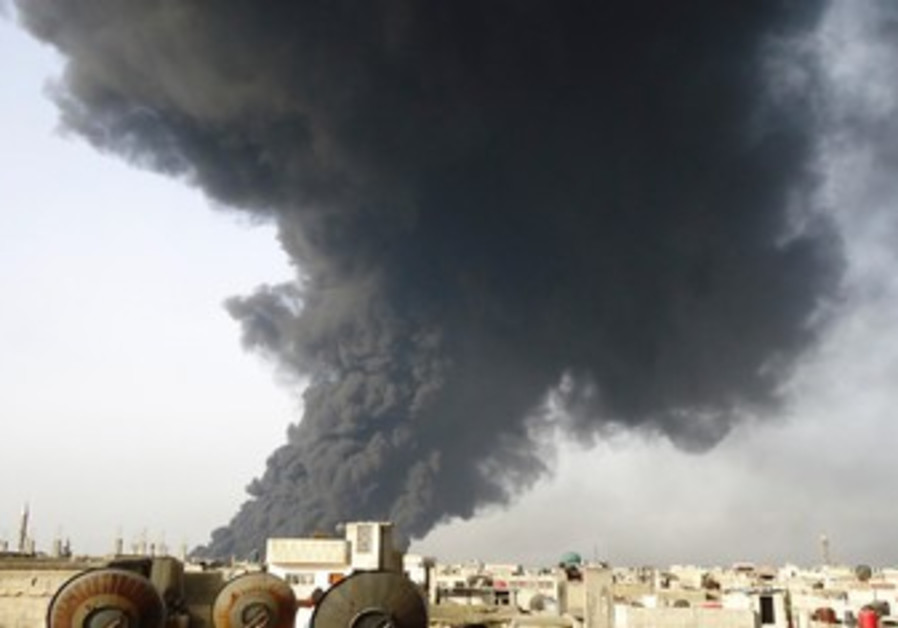 Smoke rising from Syria oil pipeline 390