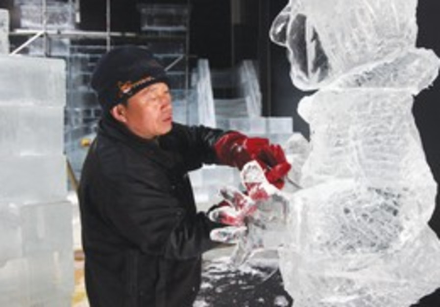 Ice carver from China building sculpture
