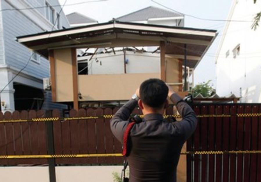 Thai policeman takes photo of terror site