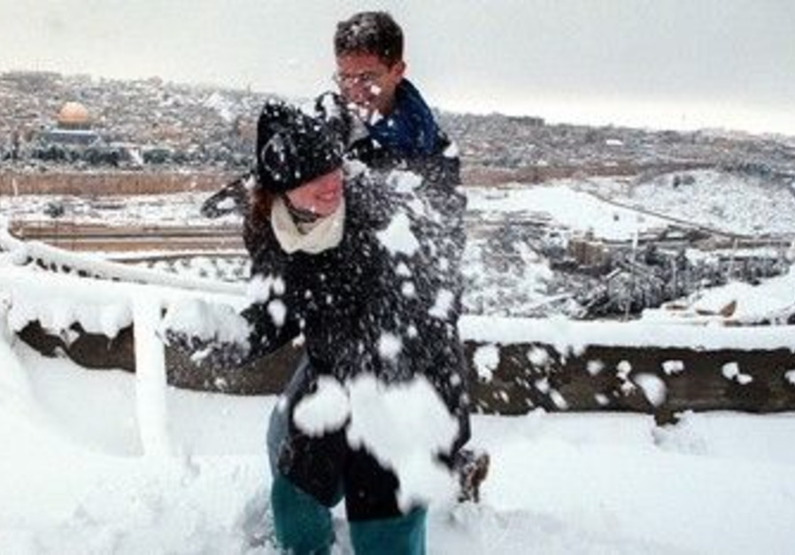 Couple playing in Jerusalem snow [file]