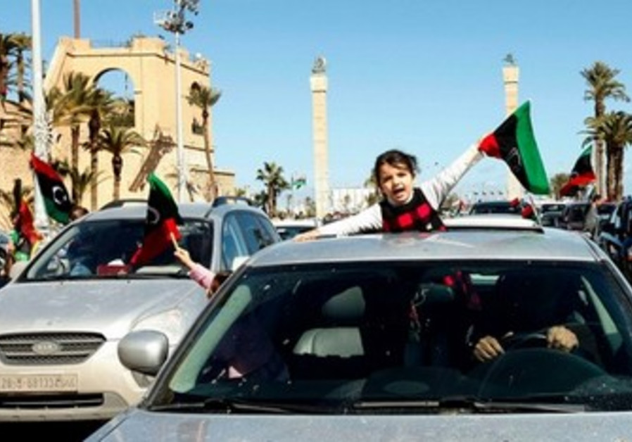 Girl waves a Libyan independence flag