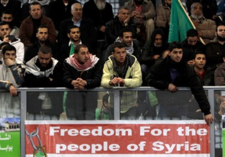 Arab Israelis protest Syrian President Assad.
