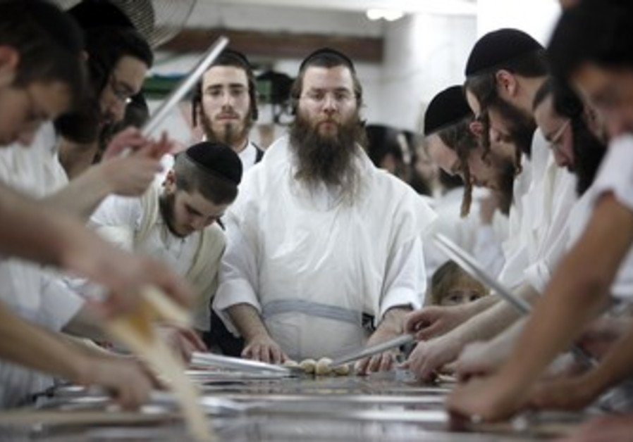 Orthodox men prepare matza