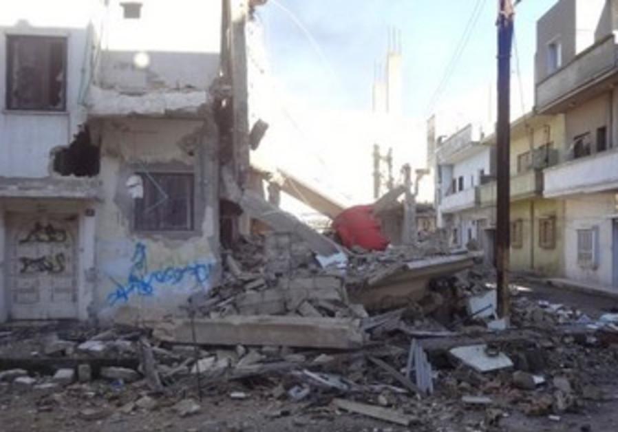 Bab Amro neighborhood of Homs following shelling