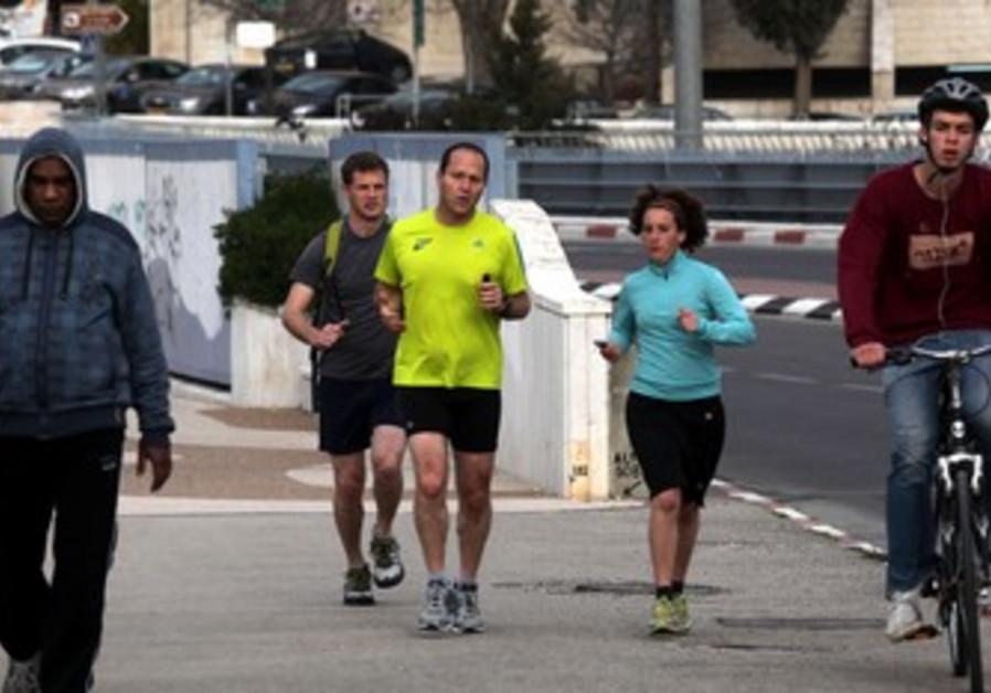 Melanie Lidman, Nir Barkat running