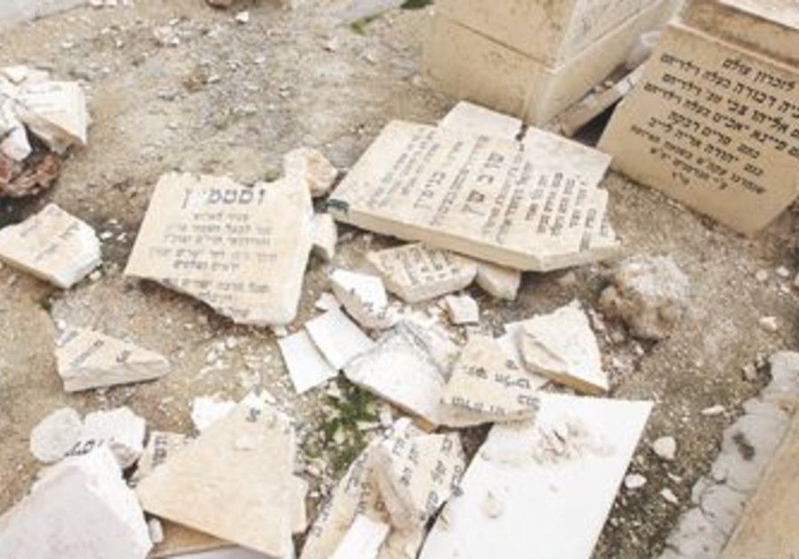 PIECES OF shattered Jewish grave stones