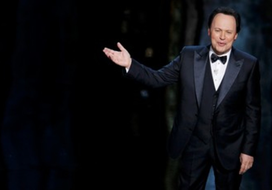 Billy Crystal on stage at the 84th Academy Awards