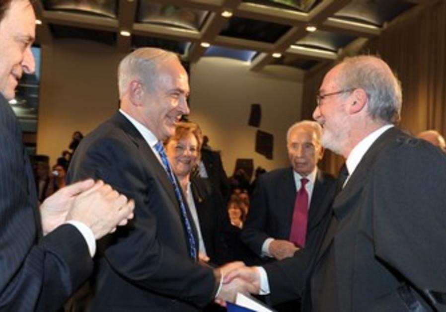 PM congratulates new Supreme Court head Grunis