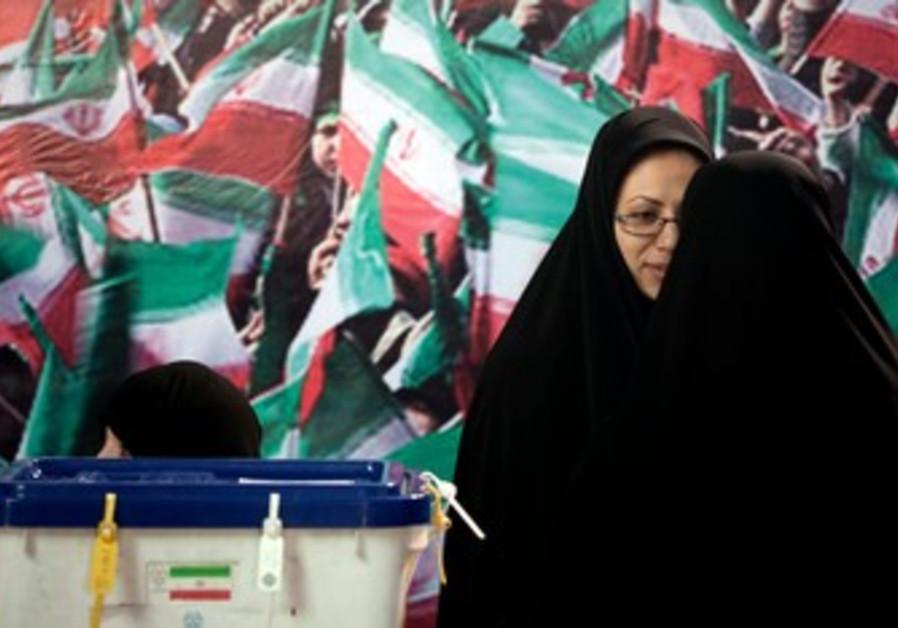 Iranian election officials at the ballot.