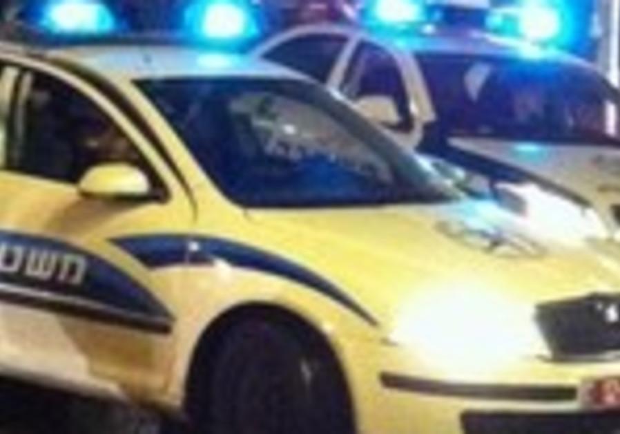 Police cars in Tel Aviv at night