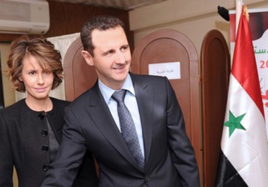 Asma Assad and Bashar Assad vote.