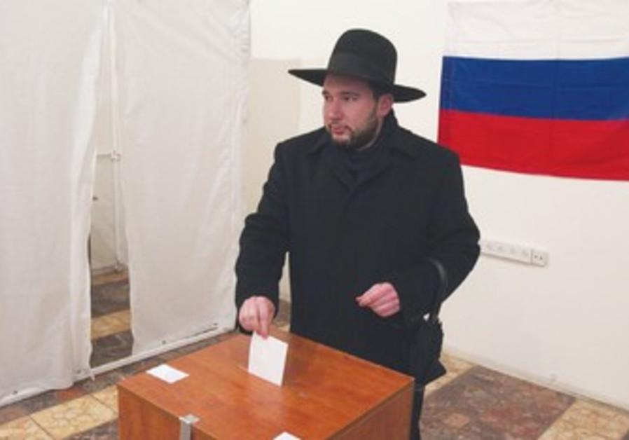 NATAN SHUSTIN, a Moscow native, casts his ballot