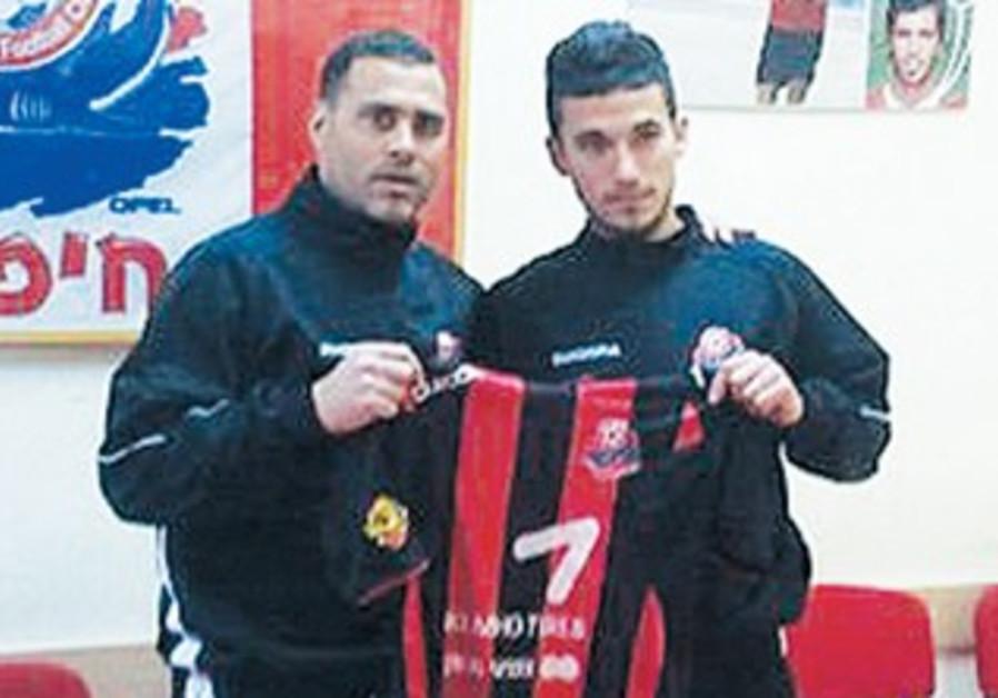 ALI KHATIB and coach Tal Banin [file]