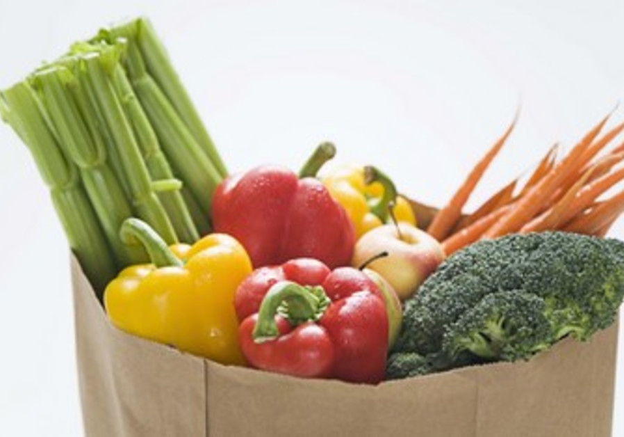 Grocery bag full of vegetables