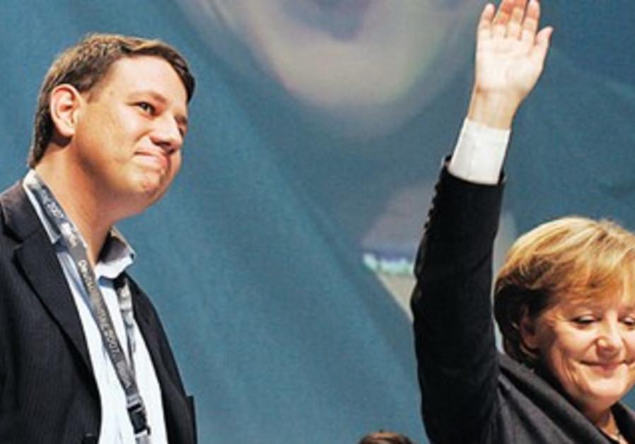 PHILIPP MISSFELDER stands next to Merkel