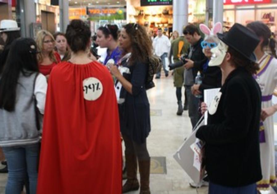demonstrators protest against consumerist culture