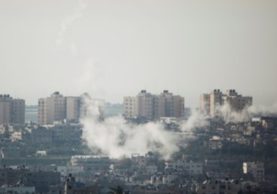 Smoke seen as rockets are fired from Gaza.
