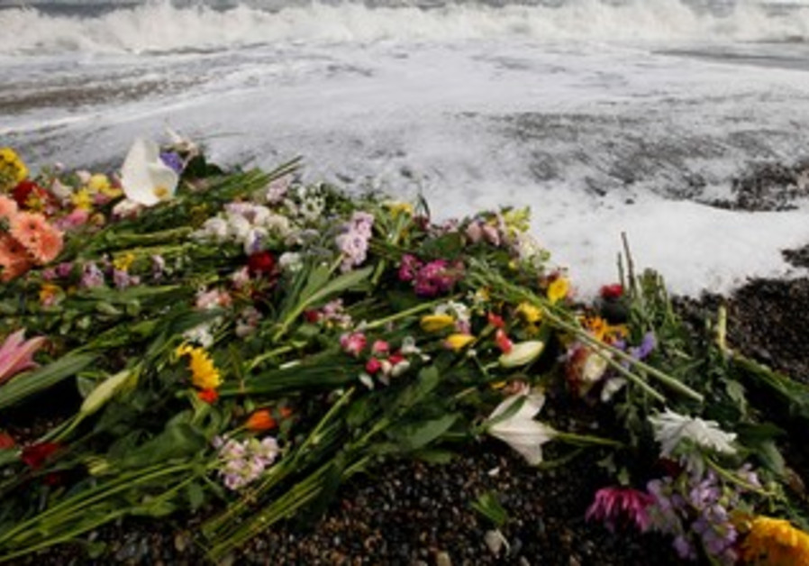 Japan mourns tsunami dead